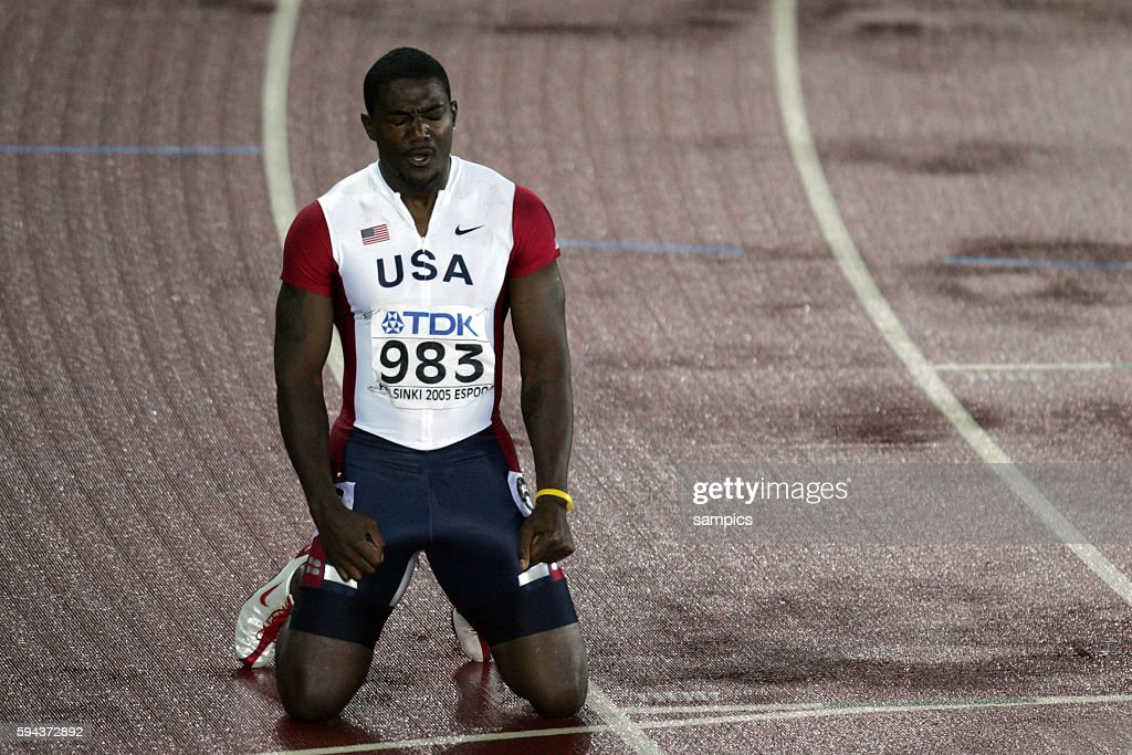 Justin Gatlin celebrates his win in the men's 200 Meter Sprint at the IAAF World Championships in Helsinki Finland August 11 2005