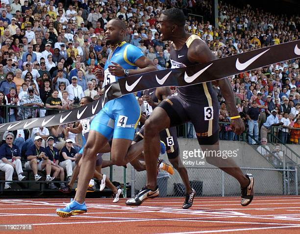 Justin Gatlin edges Asafa Powell to win the men's 100 meters in the 31st Prefontaine Classic at the University of Oregon's Hayward Field in Eugene...