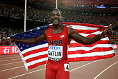 Justin Gatlin of the United States celebrates after crossing the finish line to win silver in the Men's 200 metres final during day six of the 15th...