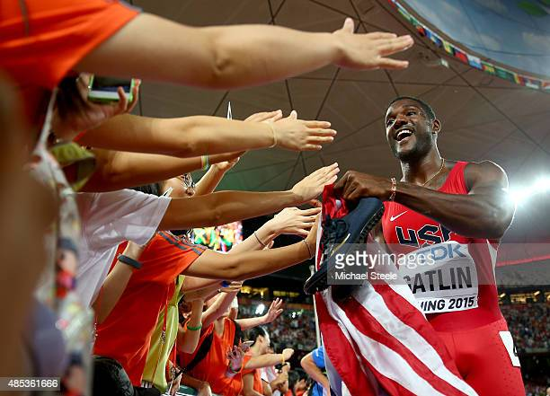 Justin Gatlin of the United States celebrates with supporters after crossing the finish line to win silver in the Men's 200 metres final during day...
