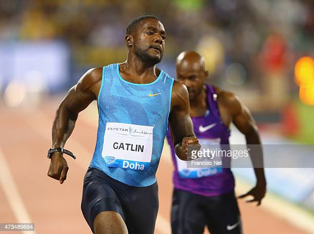 Justin Gatlin of the United States crosses the line to win the Men's 100m with Kim Collins of St Kitts and Nevis finishing fourth during the Doha...