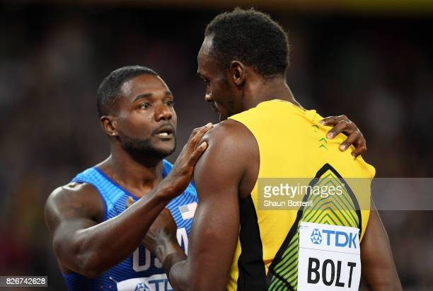Justin Gatlin of the United States is congratulated by Usain Bolt of Jamaica following his win in the Men's 100 metres final in 992 seconds during...