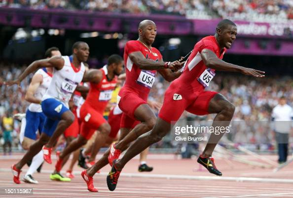 Justin Gatlin of the United States receives the relay baton from Trell Kimmons of the United States during the Men's 4 x 100m Relay Round 1 heats on...