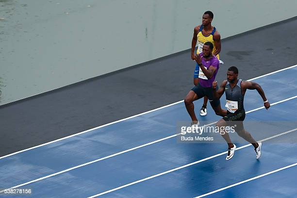 Justin Gatlin of the United States runs against Richard Thompson of Trinidad and Tobago and Vitor Hugo Santos of Brazil during the 'Mano a Mano'...