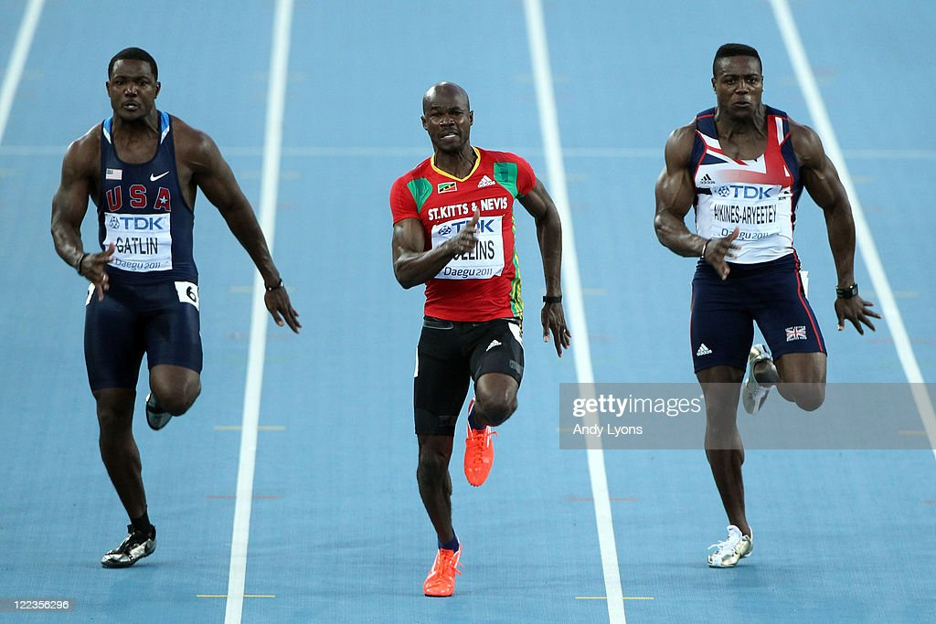 <a gi-track='captionPersonalityLinkClicked' href=/galleries/search?phrase=Justin+Gatlin&family=editorial&specificpeople=162752 ng-click='$event.stopPropagation()'>Justin Gatlin</a> of United States, <a gi-track='captionPersonalityLinkClicked' href=/galleries/search?phrase=Kim+Collins&family=editorial&specificpeople=171583 ng-click='$event.stopPropagation()'>Kim Collins</a> of Saint Kitts and Nevis and <a gi-track='captionPersonalityLinkClicked' href=/galleries/search?phrase=Harry+Aikines-Aryeetey&family=editorial&specificpeople=247216 ng-click='$event.stopPropagation()'>Harry Aikines-Aryeetey</a> of Great Britain compete during the men's 100 metres semi finals during day two of the 13th IAAF World Athletics Championships at the Daegu Stadium on August 28, 2011 in Daegu, South Korea.