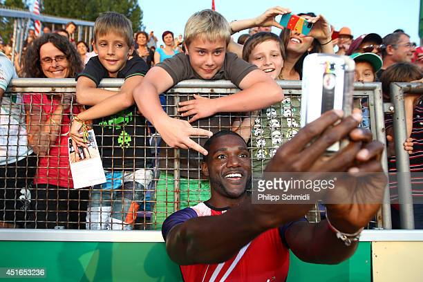 Justin Gatlin of USA celebrates after winning the Men's 100m race at the IAAF Diamond League Athletics meeting 'Athletissima' on July 3 2014 in...
