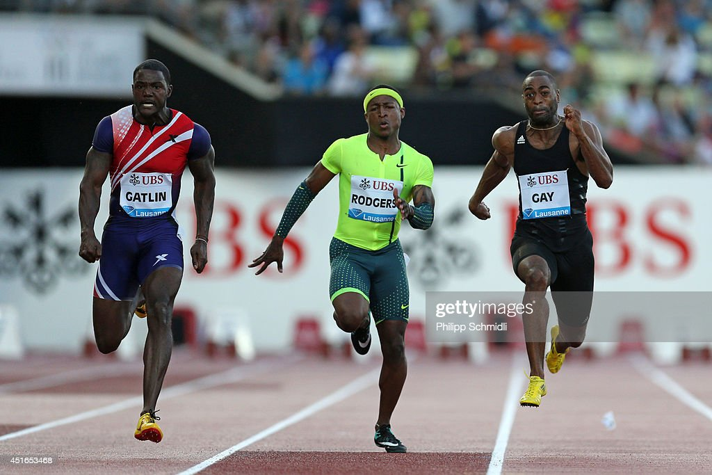Justin Gatlin of USA (L), Michael Rodgers of USA (C) and Tyson Gay of USA compete in the Men's 100m race at the IAAF Diamond League Athletics meeting 'Athletissima' on July 3, 2014 in Lausanne, Switzerland.