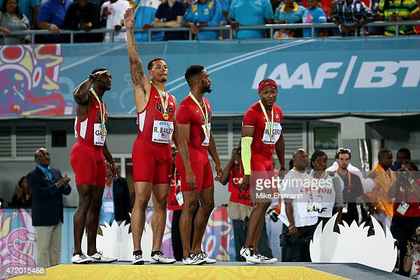 Justin Gatlin Ryan Bailey Tyson Gay and Mike Rodgers of the United States stand on the podium after winning the final of the men's 4 x 100 metres on...