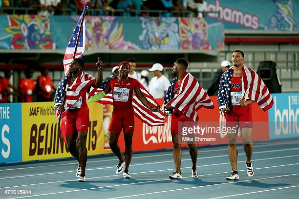 Justin Gatlin Ryan Bailey Tyson Gay and Mike Rodgers of the United States celebrate after winning the final of the men's 4 x 100 metres on day one of...