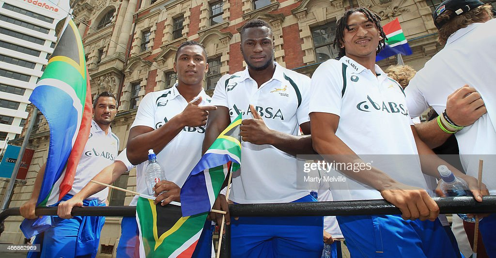 Justin Geduld, Jamba Ulengo and Sampie Mastriet wait for the parade to start during a South African street parade ahead of the 2014 Wellington Sevens on February 5, 2014 in Wellington, New Zealand.