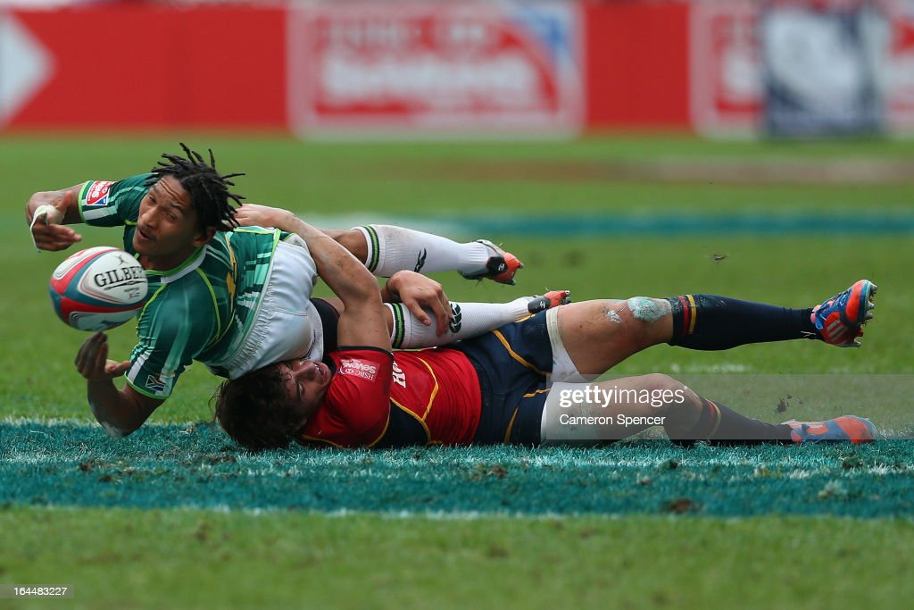 Justin Geduld of South Africa passes during the Bowl Quarter Final match between Spain and South Africa during day three of the 2013 Hong Kong Sevens...