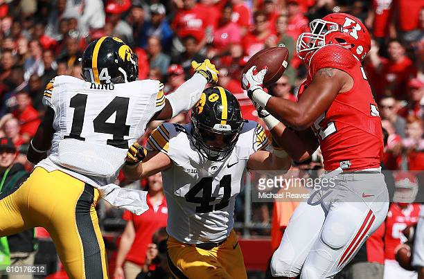 Justin Goodwin of the Rutgers Scarlet Knights makes a catch against Desmond King and Bo Bower of the Iowa Hawkeyes at High Point Solutions Stadium on...