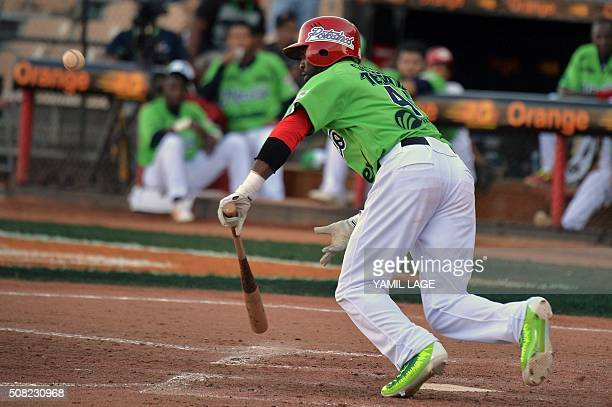 Justin Greene of Mexico hits against Venezuela during their 2016 Caribbean baseball series game on February 3 2016 in Santo Domingo AFP PHOTO/YAMIL...