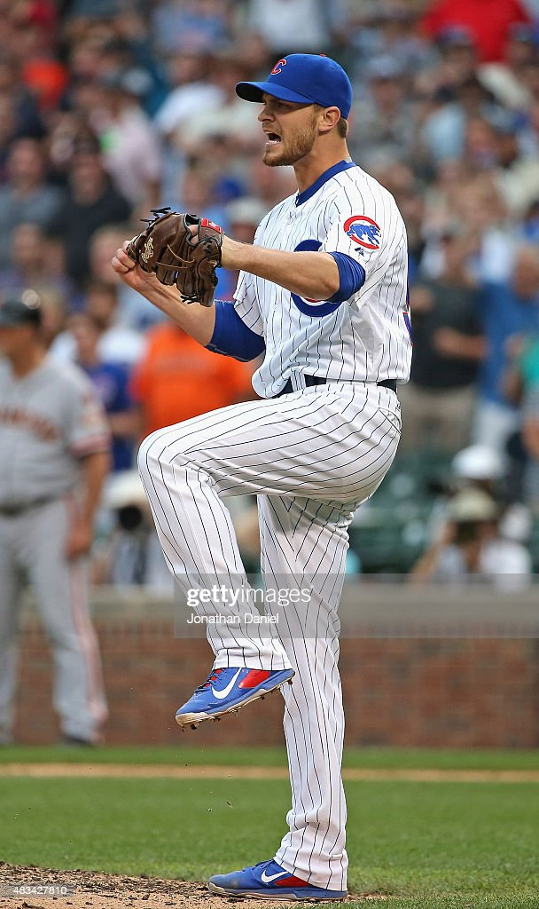 Justin Grimm of the Chicago Cubs celebrates getting the last out of the game against the San Francisco Giants at Wrigley Field on August 8 2015 in...