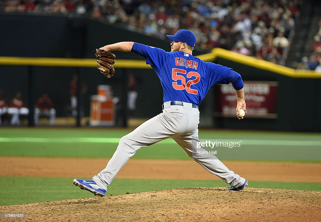 Justin Grimm of the Chicago Cubs delivers a pitch against the Arizona Diamondbacks at Chase Field on May 24 2015 in Phoenix Arizona