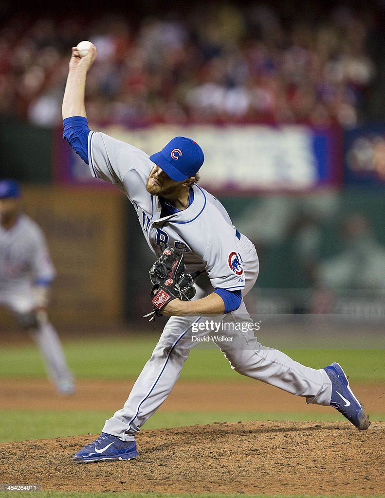Justin Grimm of the Chicago Cubs delivers a pitch in the tenth inning during a game against the St Louis Cardinals at Busch Stadium on April 11 2014...