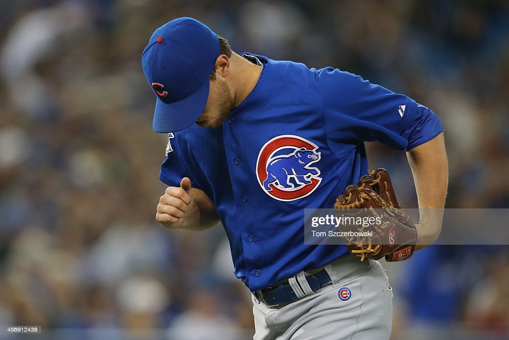 Justin Grimm of the Chicago Cubs exits the game as he is relieved in the seventh during MLB game action against the Toronto Blue Jays on September 10...