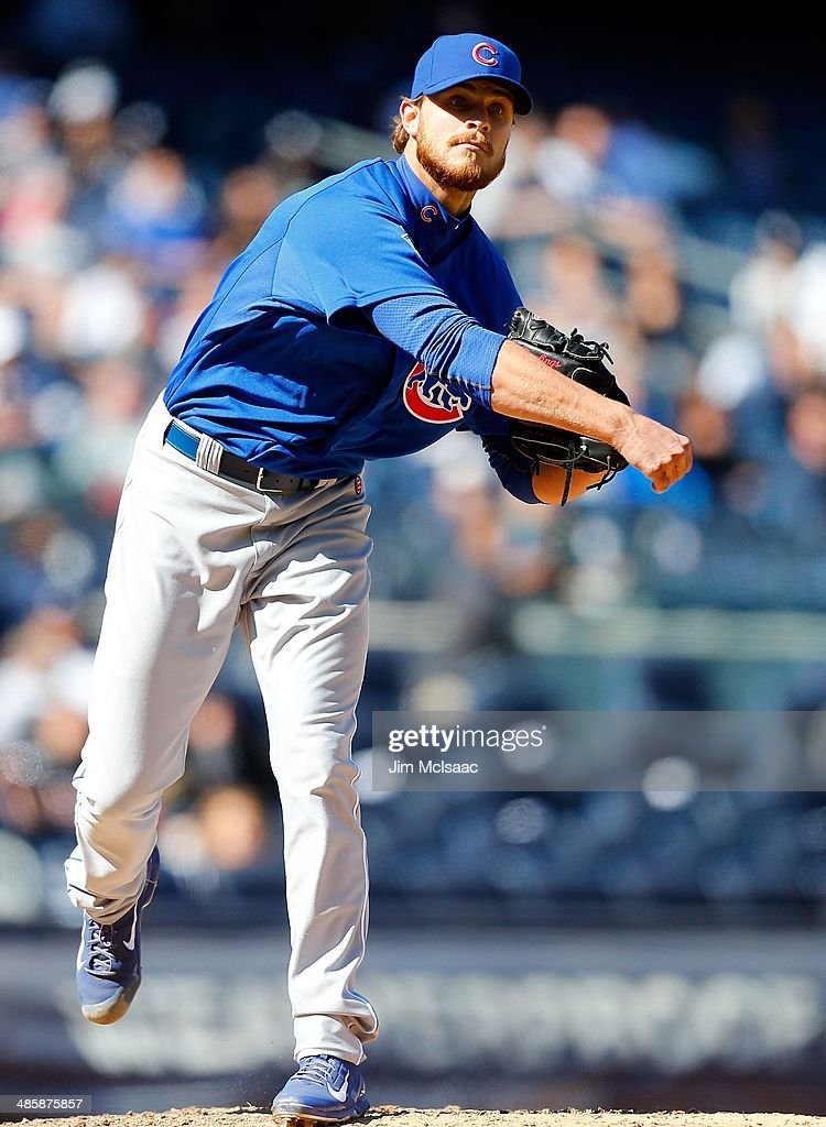 Justin Grimm of the Chicago Cubs in action against the New York Yankees during the first game of a doubleheader at Yankee Stadium on April 16 2014 in...