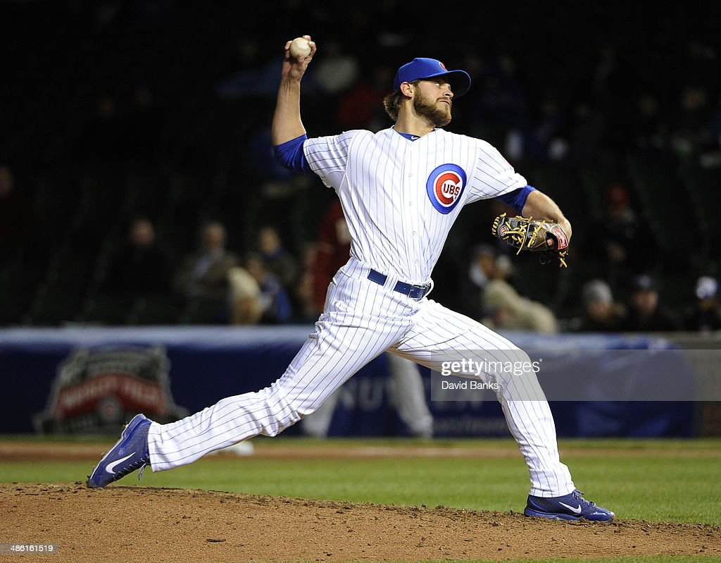 Justin Grimm of the Chicago Cubs pitches against the Arizona Diamondbacks during the eighth inning on April 22 2014 at Wrigley Field in Chicago...