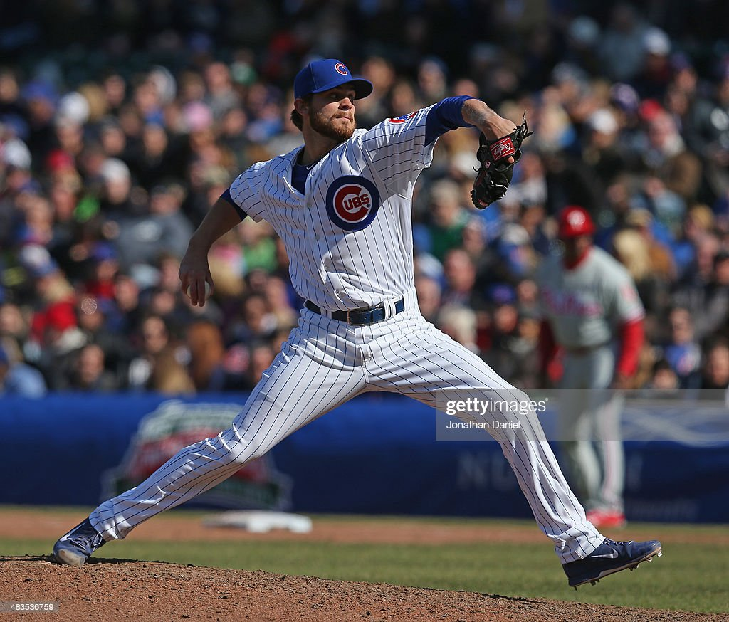 Justin Grimm of the Chicago Cubs pitches against the Philadelphia Phillies at Wrigley Field on April 5 2014 in Chicago Illinois The Phillies defeated...