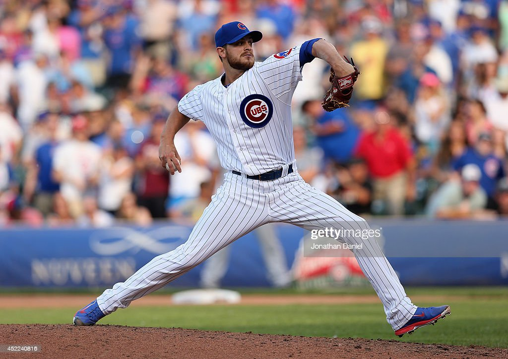 Justin Grimm of the Chicago Cubs pitches against the Washington Nationals at Wrigley Field on June 27 2014 in Chicago Illinois The Cubs defeated the...