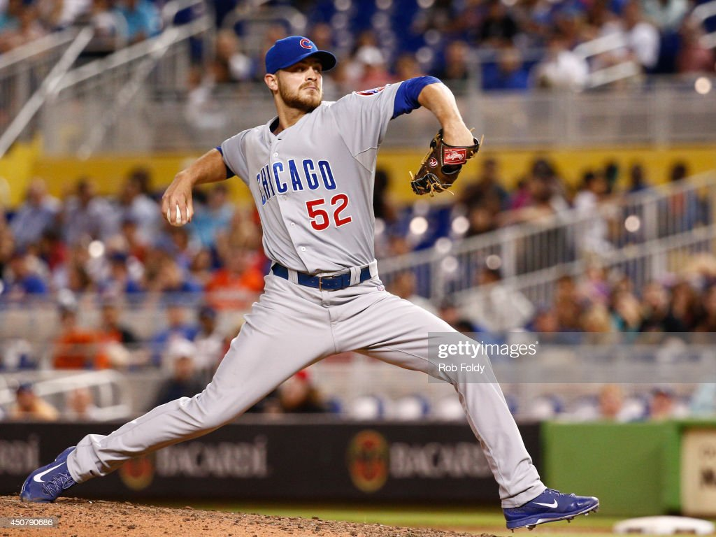 Justin Grimm of the Chicago Cubs pitches during the eighth inning of the game against the Miami Marlins at Marlins Park on June 17 2014 in Miami...