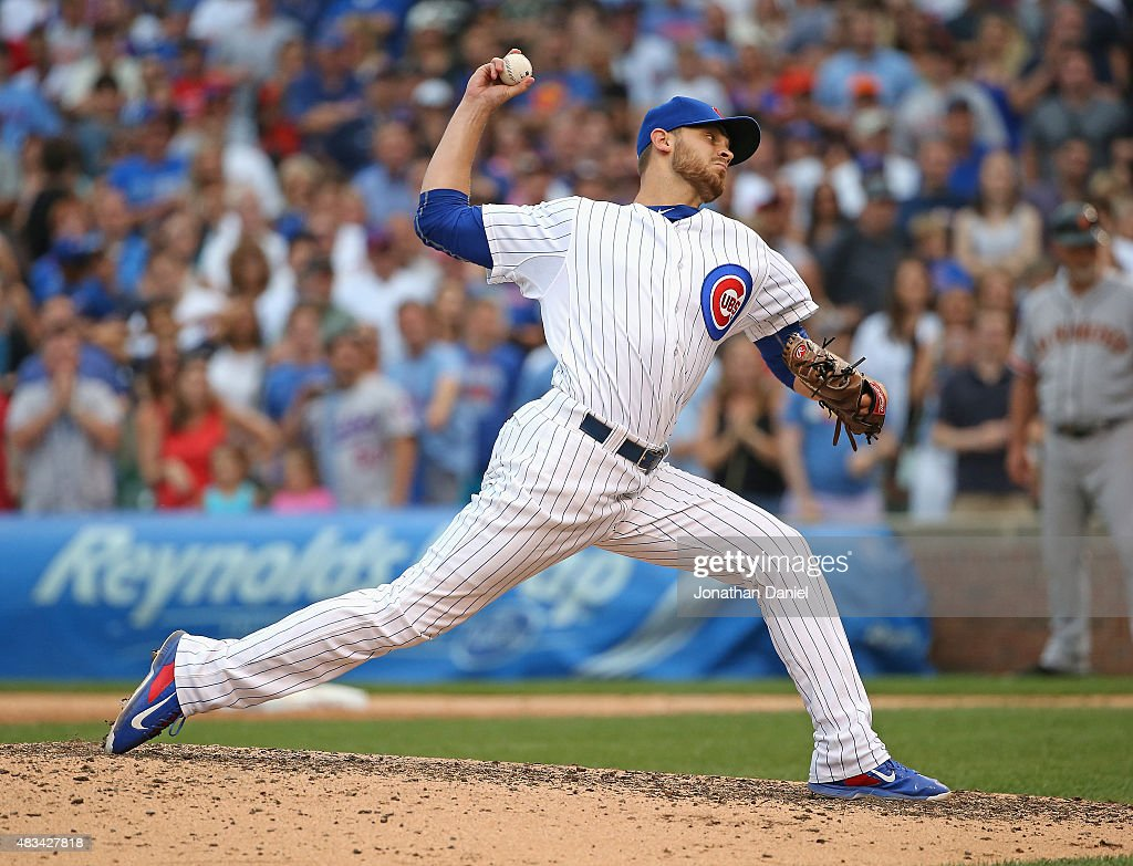 Justin Grimm of the Chicago Cubs pitches for the last out of the game against the San Francisco Giants at Wrigley Field on August 8 2015 in Chicago...