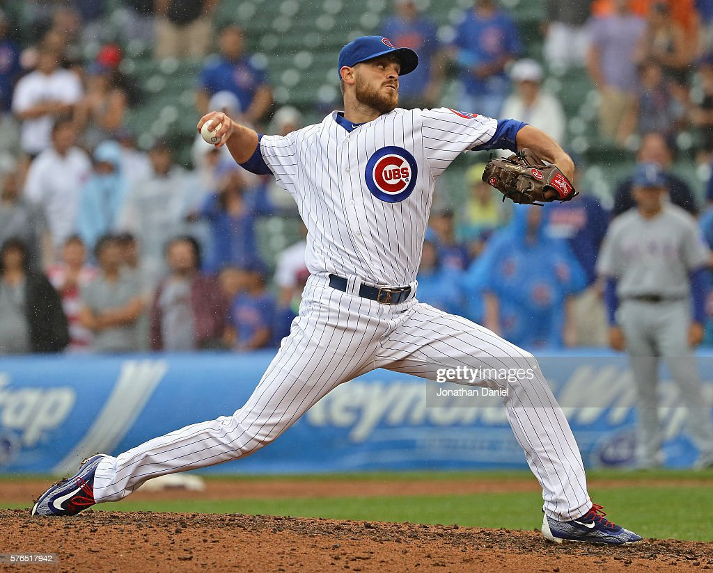 Justin Grimm of the Chicago Cubs pitches in the 9th inning against the Texas Rangers at Wrigley Field on July 15 2016 in Chicago Illinois The Cubs...