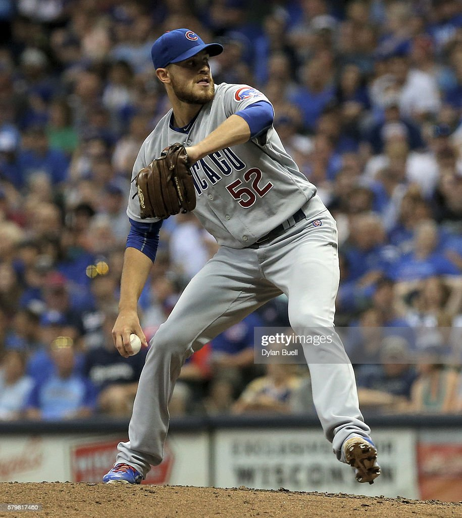Justin Grimm of the Chicago Cubs pitches in the seventh inning against the Milwaukee Brewers at Miller Park on July 22 2016 in Milwaukee Wisconsin