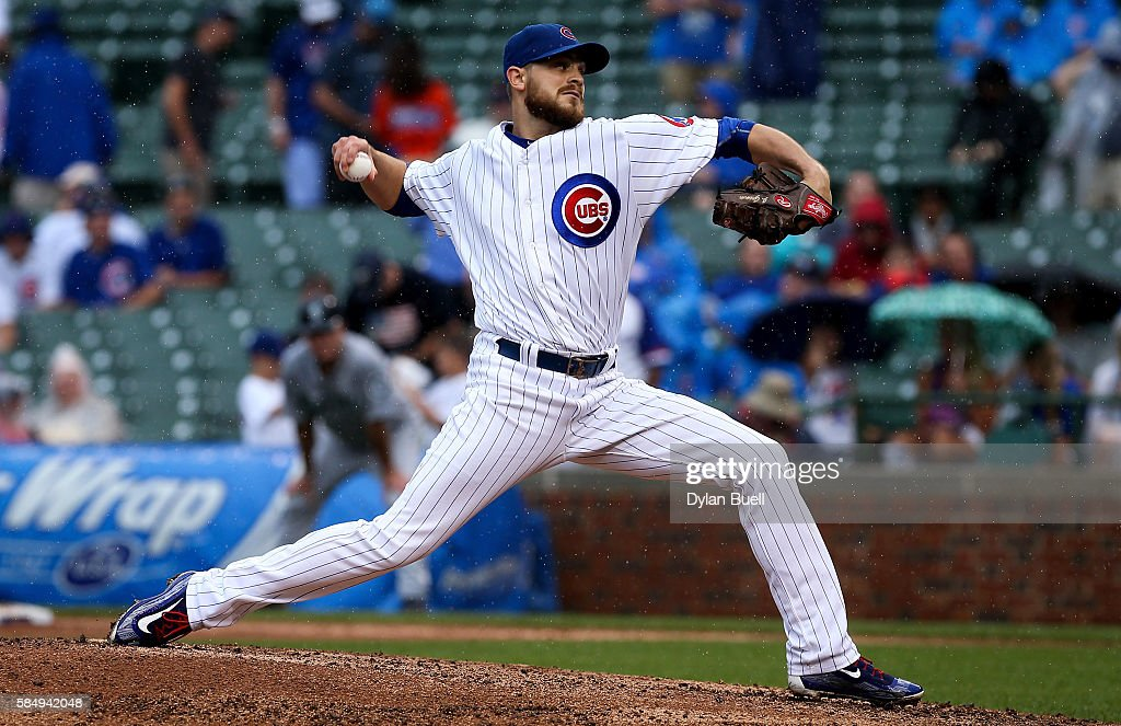 Justin Grimm of the Chicago Cubs pitches in the seventh inning against the Seattle Mariners at Wrigley Field on July 29 2016 in Chicago Illinois