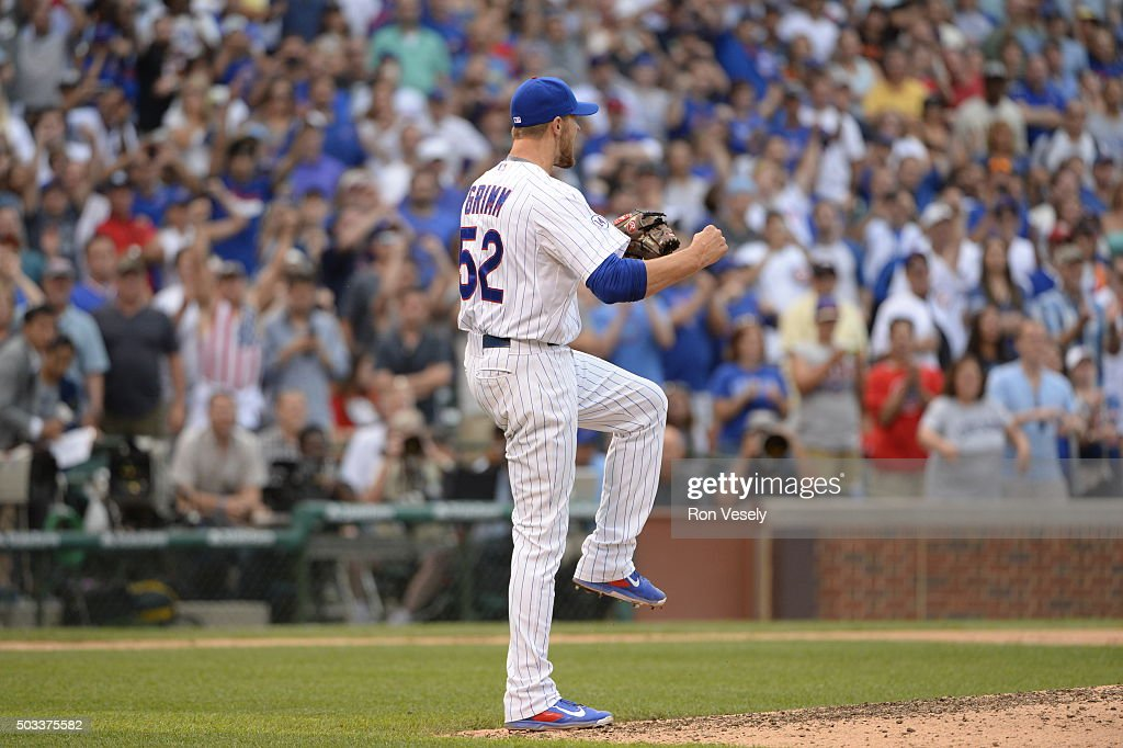 Justin Grimm #52 of the Chicago Cubs reacts after recording the final out of the game against the San Francisco Giants at Wrigley Field on Saturday, August 8, 2015 in Chicago, Illinois.