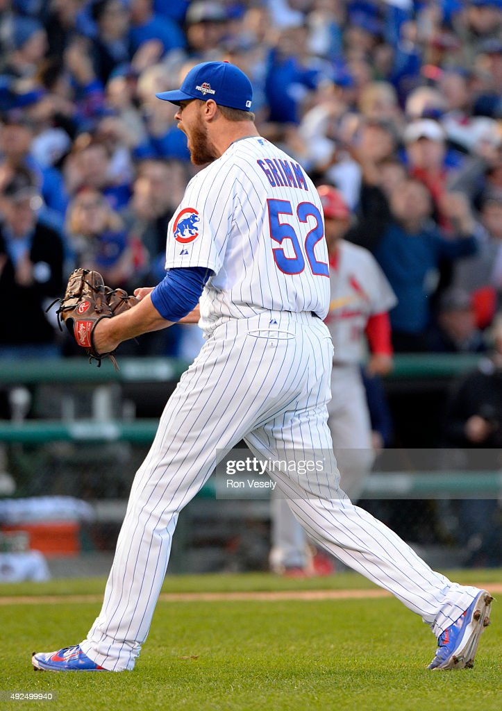 Justin Grimm #52 of the Chicago Cubs reacts after striking out Tommy Pham #60 of the St. Louis Cardinals for the third out in the top of the fourth inning of Game 4 of the NLDS at Wrigley Field on Tuesday, October 13, 2015 in Chicago , Illinois.