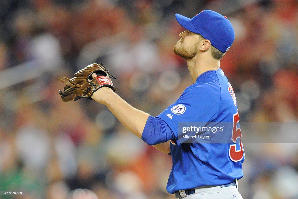 <a gi-track='captionPersonalityLinkClicked' href=/galleries/search?phrase=Justin+Grimm&family=editorial&specificpeople=9480126 ng-click='$event.stopPropagation()'>Justin Grimm</a> #52 of the Chicago Cubs reacts to pitch during a baseball game against the Washington Nationals at Nationals Park on June 5, 2015 in Washington, DC. The Nationals won 7-5.