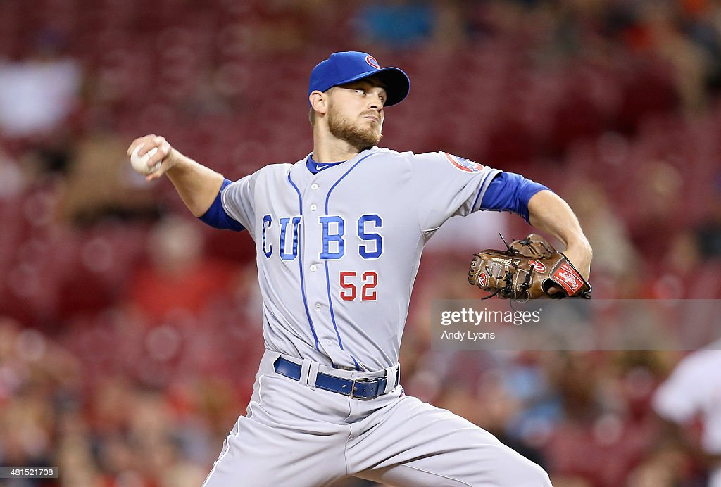 Justin Grimm of the Chicago Cubs throws a pitch against the Cincinnati Reds at Great American Ball Park on July 21 2015 in Cincinnati Ohio