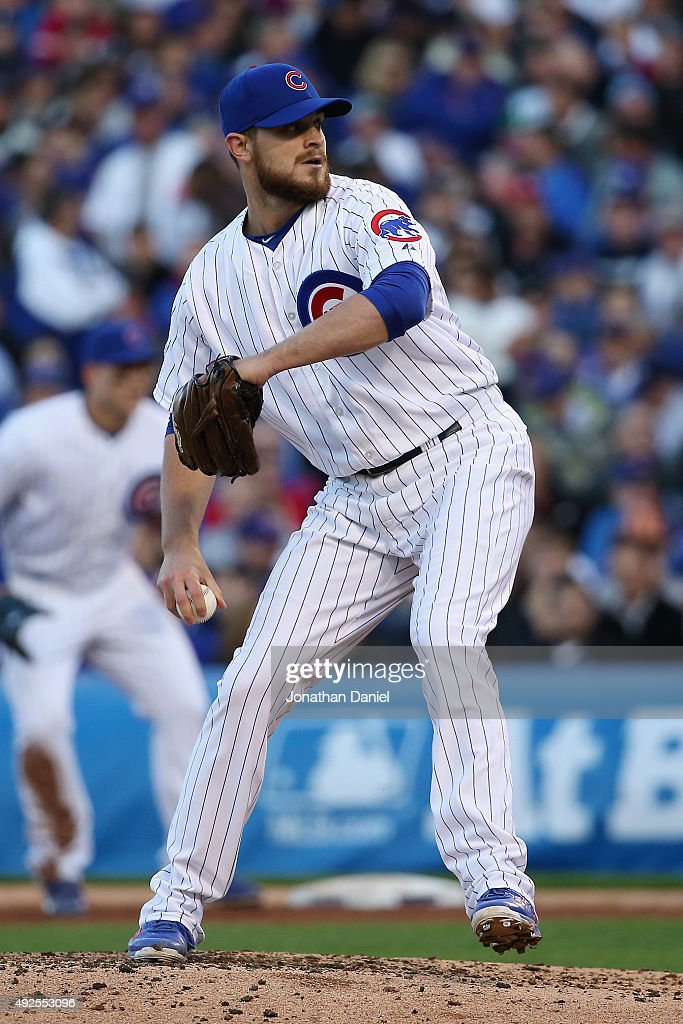 Justin Grimm of the Chicago Cubs throws a pitch in the fourth inning against the St Louis Cardinals during game four of the National League Division...