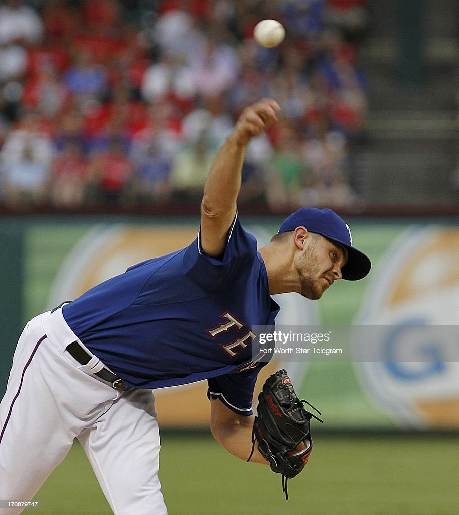 Justin Grimm of the Texas Rangers pitches against the Oakland Athletics at the Rangers Ballpark in Arlington on Wednesday, June 19, 2013, in Arlington, Texas.