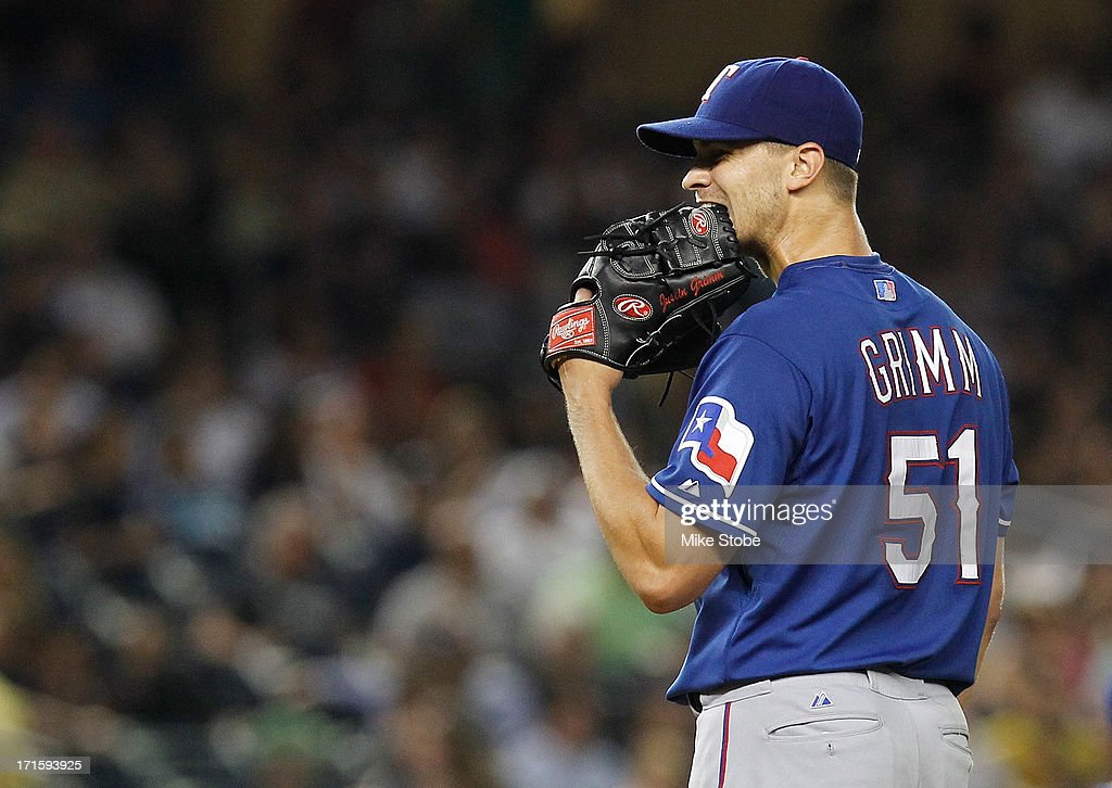 Justin Grimm #51 of the Texas Rangers reacts before being removed in the sixth inning against the New York Yankees at Yankee Stadium on June 26, 2013 in the Bronx borough of New York City.