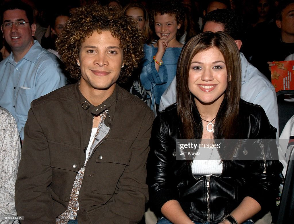 Justin Guarini and Kelly Clarkson during Nickelodeon's 16th Annual Kids' Choice Awards 2003 Backstage at Barker Hangar in Santa Monica CA United...