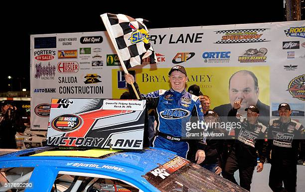 Justin Haley driver of the Braun Auto Chevrolet celebrates in Victory Lane after winning the NASCAR KN Pro Series East Kevin Whitaker Chevrolet 150...
