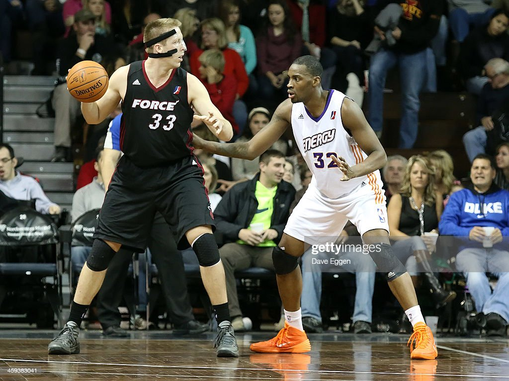 Justin Hamilton from the Sioux Falls Skyforce drives against Jarvis Varnado from the Iowa Energy in the second half of their NBA DLeague game...