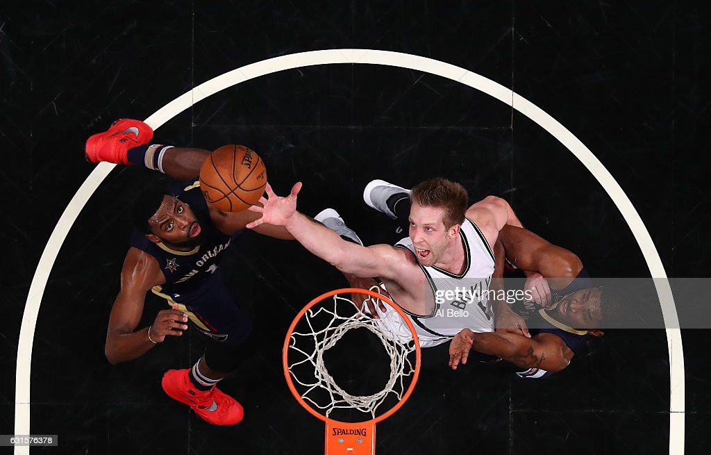 Justin Hamilton #41 of the Brooklyn Nets leaps for a rebound with Tyreke Evans #1 and E'Twaun Moore #55 of the New Orleans Pelicans during their game at the Barclays Center on January 12, 2017 in New York City.