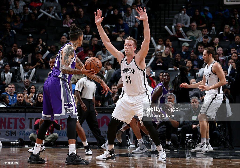 Justin Hamilton #41 of the Brooklyn Nets plays defense against Matt Barnes #22 of the Sacramento Kings on November 27, 2016 at Barclays Center in Brooklyn, NY.