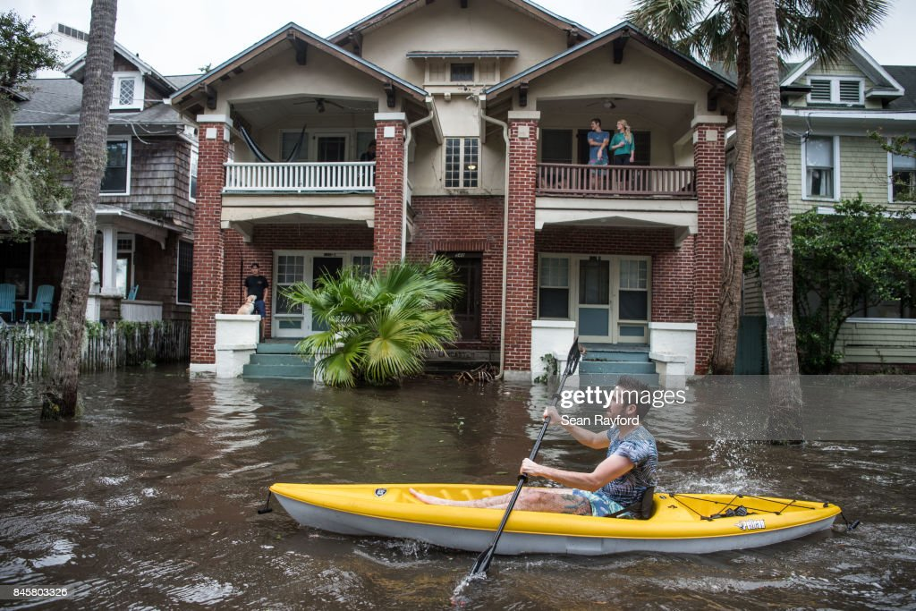 Justin Hand navigates storm surge flood waters from Hurricane Irma along the St. Johns River on Sept. 11, 2017 in Jacksonville, Florida. Flooding in downtown Jacksonville along the river topped a record set during Hurricane Dora in 1965.