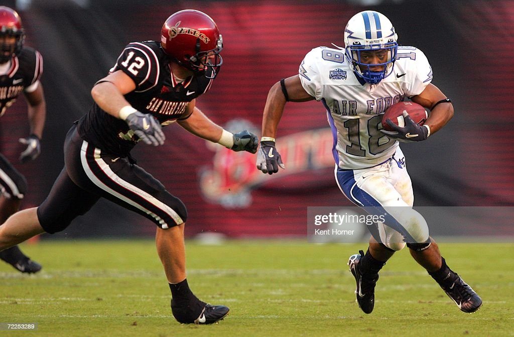 Justin Handley #18 of the Air Force Falcons runs with the ball against Brett Sturm #12 of the San Diego State Aztecs on October 21, 2006 during their game at Qualcomm Stadium in San Diego, California. San Diego State won 19-12.