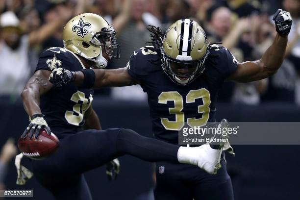 Justin Hardee of the New Orleans Saints celebrates a toudown on a blocked punt with Trey Edmunds during the first half of a game against the Tampa...