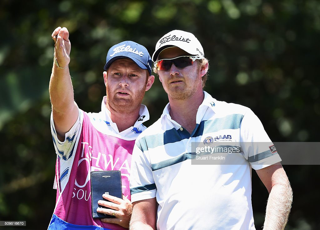 Justin Harding of South Africa and caddie discuss a shot during the first round of the Tshwane Open at Pretoria Country Club on February 11, 2016 in Pretoria, South Africa.