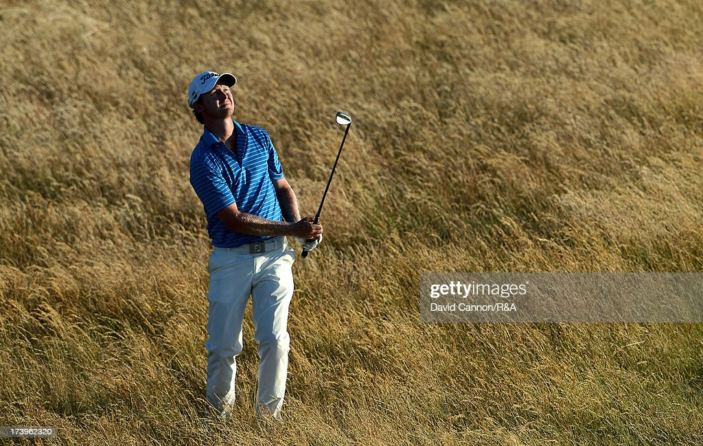 Justin Harding of South Africa plays out of the rough on the 17th hole during the first round of the 142nd Open Championship at Muirfield on July 18, 2013 in Gullane, Scotland.