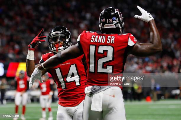 Justin Hardy of the Atlanta Falcons celebrates a touchdown with Mohamed Sanu during the second half against the Dallas Cowboys at MercedesBenz...