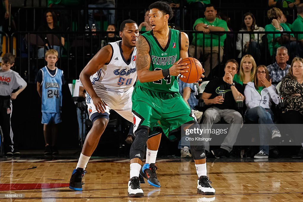 Justin Harper #24 of the Idaho Stampede defends the ball against Rodney Bartholomew #50 of the Tulsa 66ers during an NBA D-League game on March 16, 2013 at CenturyLink Arena in Boise, Idaho. The Stampede wore green jerseys for a St. Patrick's Day-related fundraiser.