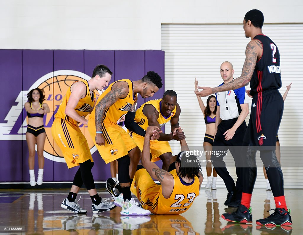 <a gi-track='captionPersonalityLinkClicked' href=/galleries/search?phrase=Justin+Harper+-+Basketball+Player&family=editorial&specificpeople=9864180 ng-click='$event.stopPropagation()'>Justin Harper</a> #23 of the Los Angeles D-Fenders gets a hand from his teammates after being fouled by <a gi-track='captionPersonalityLinkClicked' href=/galleries/search?phrase=Greg+Whittington&family=editorial&specificpeople=7636075 ng-click='$event.stopPropagation()'>Greg Whittington</a> #2 of the Sioux Falls Skyforce during Game One of the 2016 NBA D-League Finals on April 24, 2016 at the Toyota Sports Center in El Segundo, California.